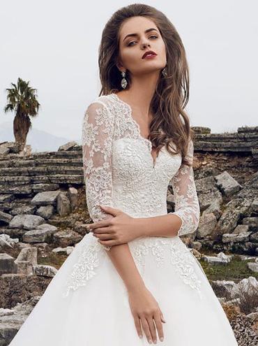 Krajkové svatební šaty s dlouhým rukávem cb46c59d0c